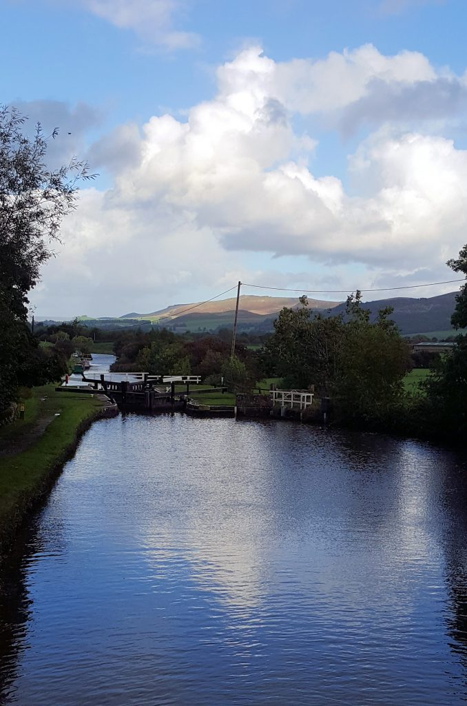 View of the Dales as Lady Teal starts up Bank Newton Locks on the Leeds Liverpool canal